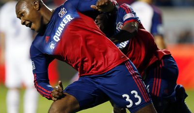 Chicago Fire forward Juan Luis Anangono, left, celebrates after scoring next to forward Patrick Nyarko, right, against Real Salt Lake during the first half of an MLS soccer game on Saturday, May 3, 2014, at Toyota Park in Bridgeview, Ill. (AP Photo/Kamil Krzaczynski)