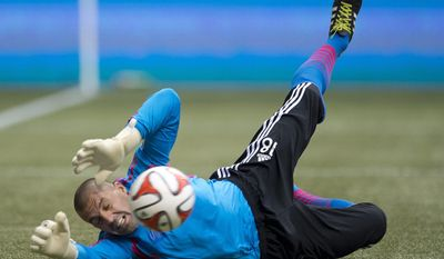 Vancouver Whitecaps FC's Kekuta Manneh's shot goes past San Jose Earthquakes goal keeper Jon Busch during the first half of an MLS soccer game action in Vancouver, Saturday, May, 3, 2013. (AP Photo/The Canadian Press, Jonathan Hayward)