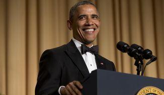 President Barack Obama smiles while making a joke during his speech at the White House Correspondents' Association (WHCA) Dinner at the Washington Hilton Hotel, Saturday, May 3, 2014, in Washington. (AP Photo/Jacquelyn Martin)