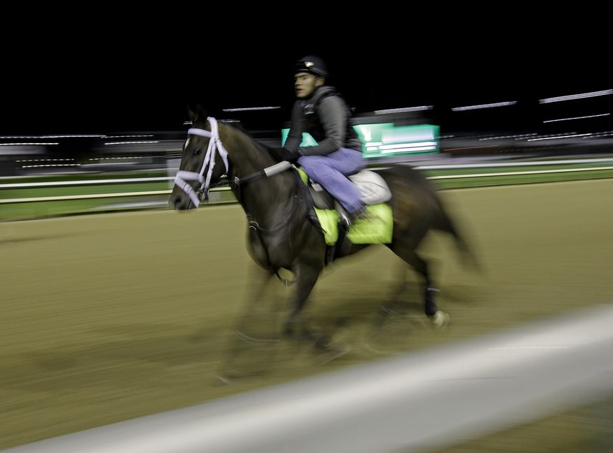 Exercise rider Joel Barrientos takes Kentucky Derby entrant Vicar's in Trouble for a morning workout during a morning workout at Churchill Downs Friday, May 2, 2014, in Louisville, Ky. (AP Photo/Morry Gash)