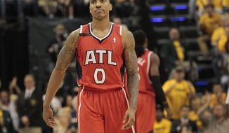 Atlanta Hawks guard Jeff Teague (0) reacts to a call in the second half during Game 7 of a first-round NBA basketball playoff series against the Indiana Pacers in Indianapolis, Saturday, May 3, 2014. The Pacers won 92-80. (AP Photo/AJ Mast)
