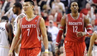 Houston Rockets' Jeremy Lin (7) and Dwight Howard (12) react to a foul call against the Portland Trail Blazers during the final minutes of game six of an NBA basketball first-round playoff series game in Portland, Ore., Friday May 2, 2014. The Trail Blazers won the series in a 99-98 win. (AP Photo/Greg Wahl-Stephens)