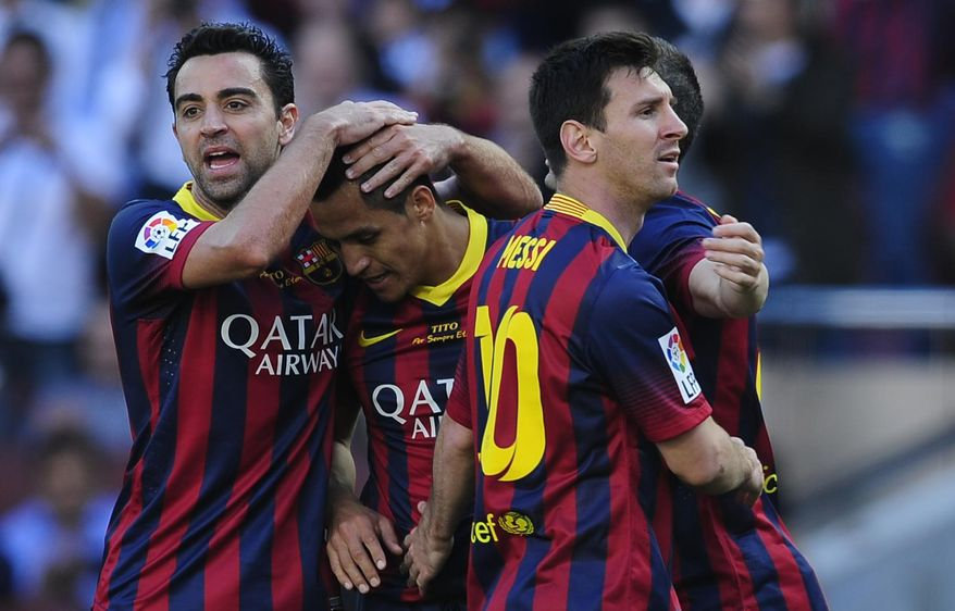 FC Barcelona's Alexis Sanchez, second left, celebrates scoring against Getafe with his teammates Xavi Hernandez, left, and Lionel Messi, from Argentina during a Spanish La Liga soccer match at the Camp Nou stadium in Barcelona, Spain, Saturday May 3, 2014. (AP Photo/Manu Fernandez)