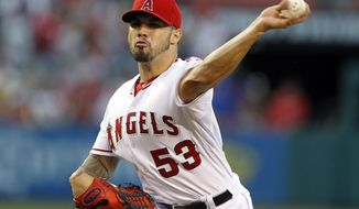 Los Angeles Angels starting pitcher Hector Santiago throws against the Texas Rangers in the first inning of a baseball game on Friday, May 2, 2014, in Anaheim, Calif. (AP Photo/Alex Gallardo)