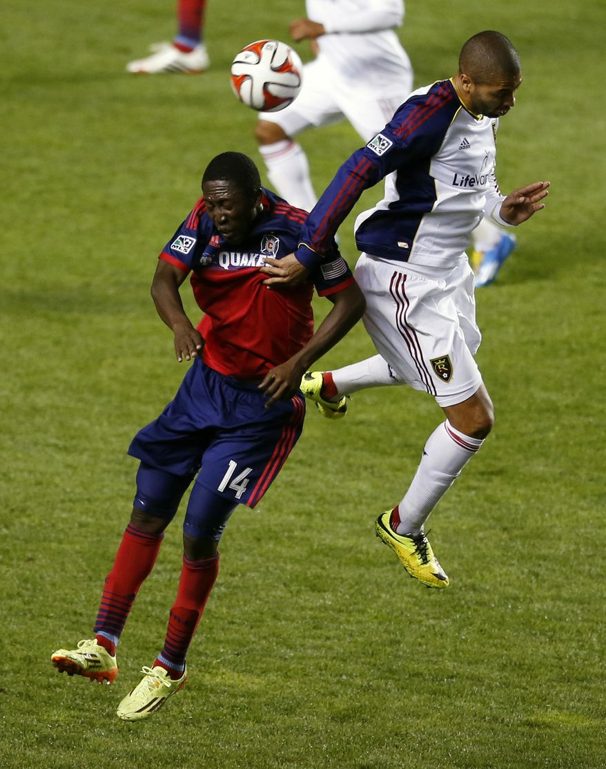 Chicago Fire forward Patrick Nyarko, left, fights for control of the ball with Real Salt Lake defender Chris Schuler, right, during the first half of an MLS soccer game on Saturday, May 3, 2014, at Toyota Park in Bridgeview, Ill. (AP Photo/Kamil Krzaczynski)