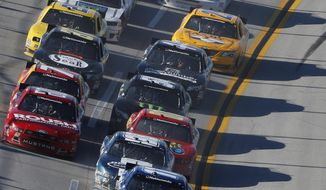 Elliott Sadler (11) leads a pack of cars during the NASCAR Aaron's 312 Nationwide series auto race at Talladega Superspeedway, Saturday, May 3, 2014, in Talladega, Ala. (AP Photo/John Bazemore)