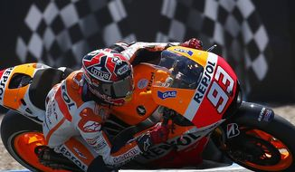 Marc Marquez from Spain and Honda Repsol races during the qualifying for the Spain MotoGP at the Jerez race track on Saturday, May 3, 2014 in Jerez de la Frontera, southern Spain. (AP Photo/Miguel Angel Morenatti )