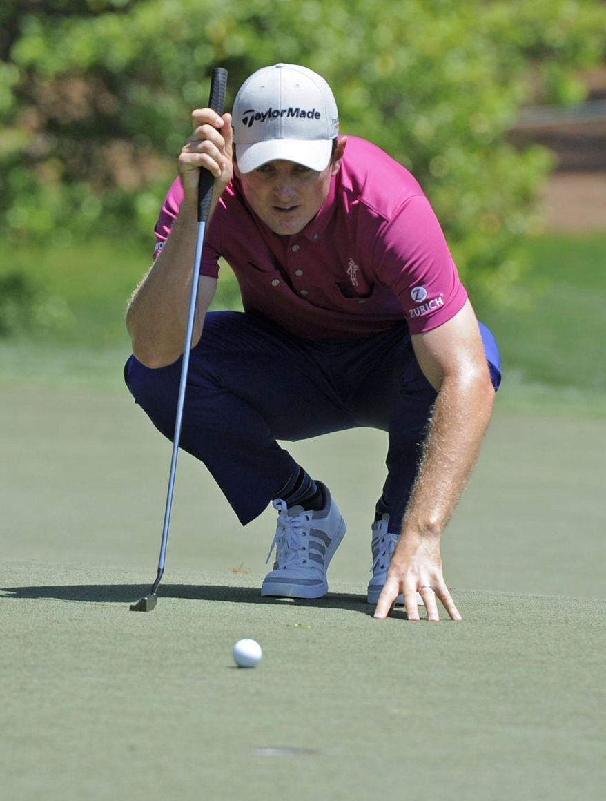 Justin Rose, of England, lines up a putt on the fifth hole during the third round of the Wells Fargo Championship golf tournament in Charlotte, N.C., Saturday, May 3, 2014. (AP Photo/Mike McCarn)