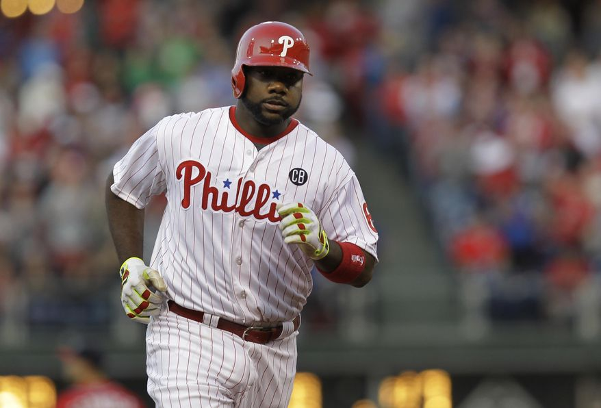 Philadelphia Phillies' Ryan Howard runs the bases on his home run in the first inning of a baseball game against the Washington Nationals, Saturday, May 3, 2014, in Philadelphia. (AP Photo/Laurence Kesterson)