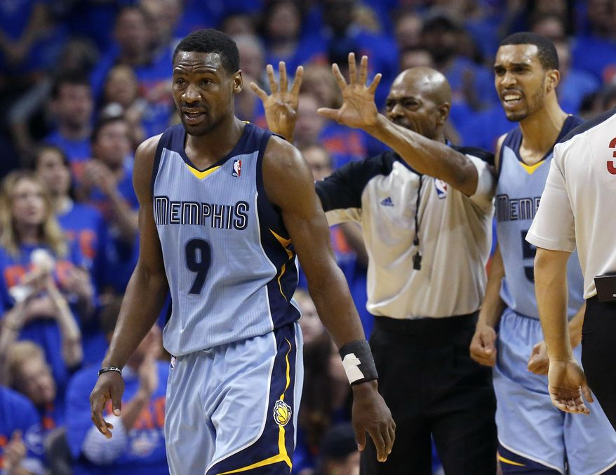 Memphis Grizzlies guard Tony Allen (9) walks back towards the bench as official Tom Washington, center, calls a foul on Allen in the second quarter of Game 7 of an opening-round NBA basketball playoff series against the Oklahoma City Thunder in Oklahoma City, Saturday, May 3, 2014. Grizzlies guard Courtney Lee is at right. (AP Photo/Sue Ogrocki)