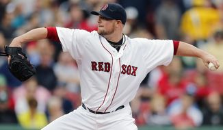 Boston Red Sox's Jon Lester pitches in the first inning of a baseball game against the Oakland Athletics in Boston, Saturday, May 3, 2014. (AP Photo/Michael Dwyer)