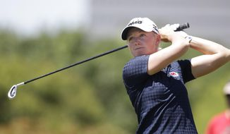 Stacy Lewis watches her tee shot on the 11th hole during the third round of the North Texas LPGA Shootout golf tournament at Las Colinas Country Club in Irving, Texas, Saturday, May 3, 2014. (AP Photo/LM Otero)