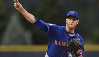 New York Mets starting pitcher Zack Wheeler (45) throws to the plate against the Colorado Rockies during the first inning of a baseball game, Friday, May 2, 2014, in Denver. (AP Photo/Jack Dempsey)