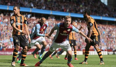 Aston Villa's Andreas Weimann, center right, celebrates scoring his side's second goal during their English Premier League soccer match against Hull City at Villa Park, Birmingham, England, Saturday, May 3, 2014. (AP Photo/Nick Potts, PA Wire)     UNITED KINGDOM OUT   -   NO SALES   -   NO SALES
