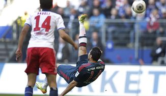 Hamburg's Milan Badelj of Croatia, left, watches as Bayern's Claudio Pizarro of Peru, right, scores his side's fourth goal during the German Bundesliga soccer match between Hamburger SV and FC Bayern Munich in Hamburg, Germany, Saturday, May 3, 2014. (AP Photo/Michael Sohn)