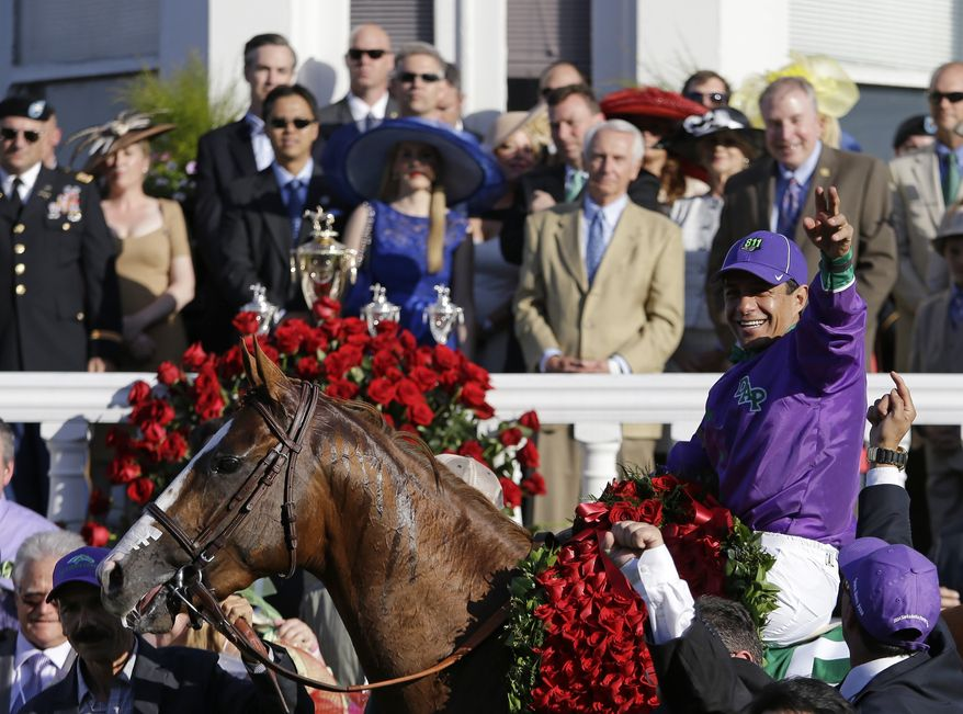 Victor Espinoza celebrates after riding California Chrome to victory in the 140th running of the Kentucky Derby horse race at Churchill Downs Saturday, May 3, 2014, in Louisville, Ky. (AP Photo/David Goldman)