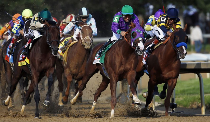 Victor Espinoza rides California Chrome around turn four to a victory during the 140th running of the Kentucky Derby horse race at Churchill Downs Saturday, May 3, 2014, in Louisville, Ky. (AP Photo/Matt Slocum)