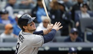 Tampa Bay Rays' Wil Myers hits a third-inning inside-the-park home run off New York Yankees starting pitcher CC Sabathia in a baseball game at Yankee Stadium in New York, Sunday, May 4, 2014. (AP Photo/Kathy Willens)