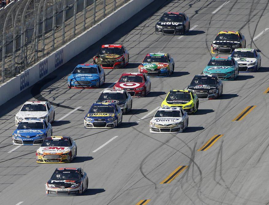 Denny Hamlin (11) heads to the finish line during the NASCAR Aaron's 499 Sprint Cup series auto race at Talladega Superspeedway, Sunday, May 4, 2014, in Talladega, Ala. Hamlin won the race. (AP Photo/John Bazemore)