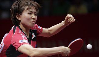 Sayaka Hirano of Japan returns a shot to Ng Wing Nam of Hong Kong during their semifinal match of the World Team Table Tennis Championships in Tokyo, Sunday, May 4, 2014. (AP Photo/Shizuo Kambayashi)