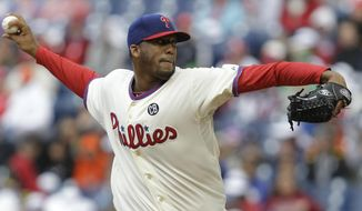 Philadelphia Phillies' pitcher Roberto Hernandez throws in the first inning of a baseball game against the Washington Nationals, Sunday, May 4, 2014, in Philadelphia. (AP Photo/Laurence Kesterson)