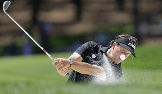 Phil Mickelson hits from a sand trap on the fifth hole during the final round of the Wells Fargo Championship golf tournament in Charlotte, N.C., Sunday, May 4, 2014. (AP Photo/Bob Leverone)