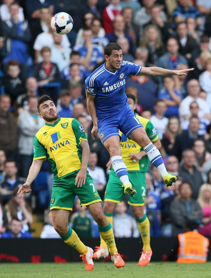 Chelsea's Eden Hazard, right, out jumps Norwich City's Robert Snodgrass during their English Premier League soccer match between Chelsea and Norwich City at Stamford Bridge stadium in London Sunday, May 4, 2014. (AP Photo/Alastair Grant)