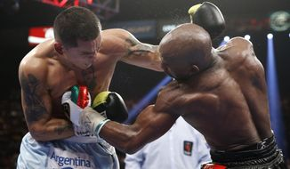 Marcos Maidana, left, from Argentina, and Floyd Mayweather Jr. brawl late in their WBC-WBA welterweight title boxing fight Saturday, May 3, 2014, in Las Vegas. Mayweather won the bout by majority decision. (AP Photo/Eric Jamison)