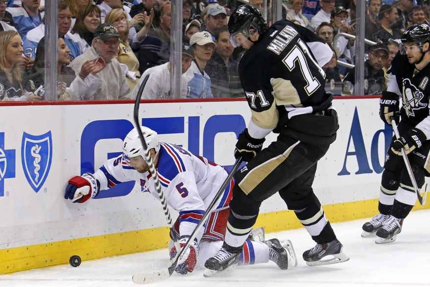 Pittsburgh Penguins' Evgeni Malkin (71) collides with New York Rangers' Dan Girardi (5) in the second period of game 2 of a second-round NHL playoff hockey series in Pittsburgh Sunday, May 4, 2014. (AP Photo/Gene J. Puskar)
