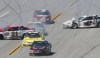 Trevor Bayne (21) and Brad Keselowski (2) are sideways after colliding with cars during the NASCAR Aaron's 499 Sprint Cup series auto race at Talladega Superspeedway, Sunday, May 4, 2014, in Talladega, Ala. (AP Photo/John Bazemore)
