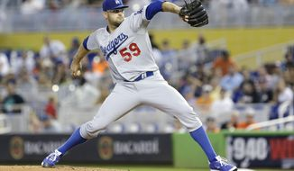 Los Angeles Dodgers' Stephen Fife delivers a pitch during the first inning of a baseball game against the Miami Marlins, Sunday, May 4, 2014, in Miami. (AP Photo/Wilfredo Lee)