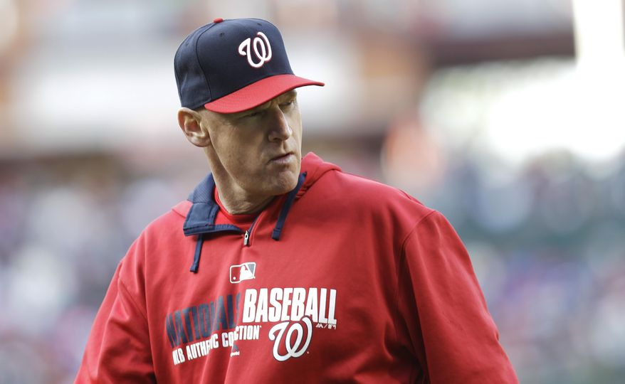 Washington Nationals manager Matt Williams walks back to the dugout after removing pitcher Gio Gonzalez from the mound in the eighth inning of a baseball game against the Philadelphia Phillies, Sunday, May 4, 2014, in Philadelphia. The Phillies won 1-0. (AP Photo/Laurence Kesterson)