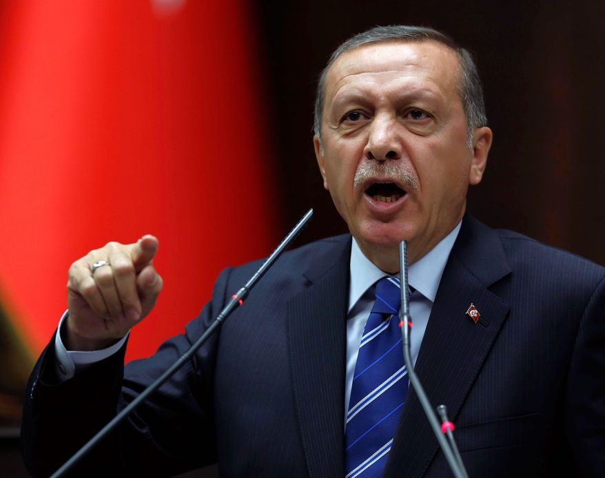 """Prime Minister Recep Tayyip Erdogan ordered Twitter and YouTube blocked and even threatened to """"eradicate Twitter"""" to show the international community """"the power of the Turkish republic."""" (Associated Press)"""