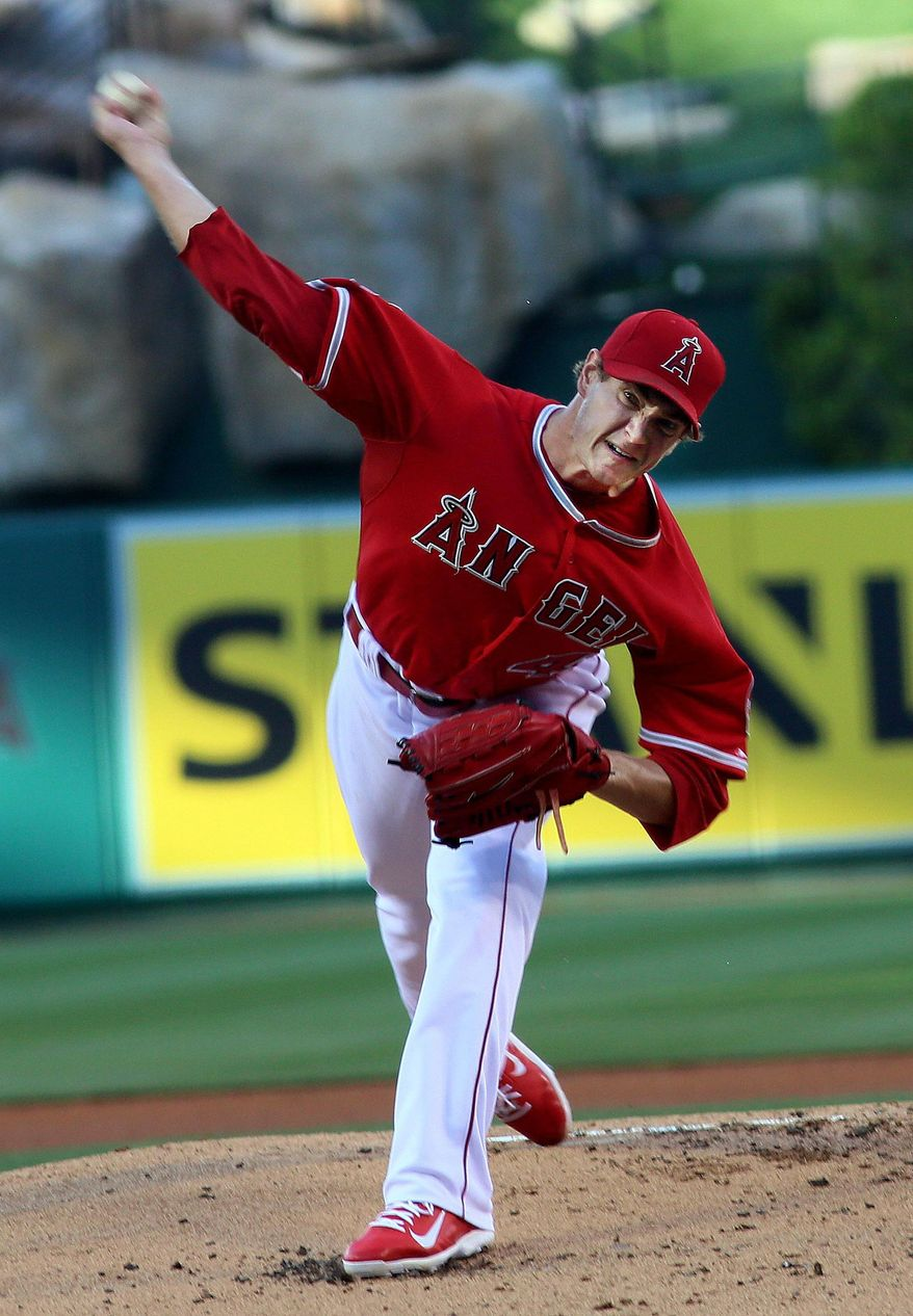 Anaheim Angels starting pitcher Garrett Richards throws during the first inning of a baseball game against the Texas Rangers at Anaheim Stadium in Anaheim, Calif., Saturday, May 3, 2014. (AP Photo/Sandy Huffaker)