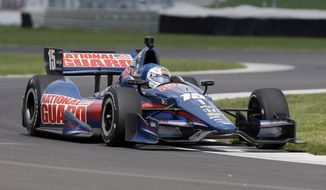 Graham  Rahal takes a turn during testing for the inaugural Grand Prix of Indianapolis auto race on the new road course at Indianapolis Motor Speedway in Indianapolis, Wednesday, April 30, 2014. (AP Photo/Michael Conroy)
