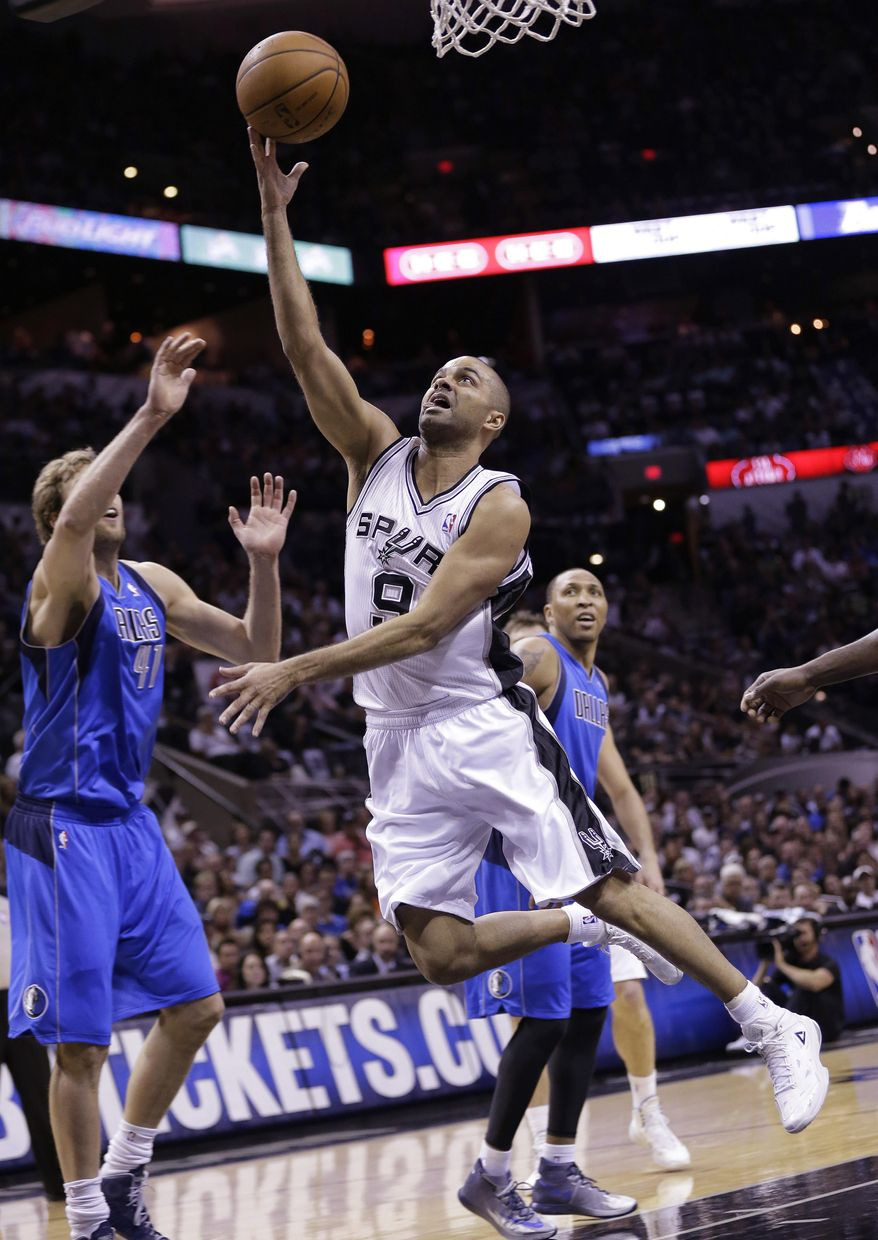 San Antonio Spurs' Tony Parker (9), of France, shoots over Dallas Mavericks' Dirk Nowitzki (41), of Germany, during the first half of Game 7 of the opening-round NBA basketball playoff series, Sunday, May 4, 2014, in San Antonio. (AP Photo/Eric Gay)