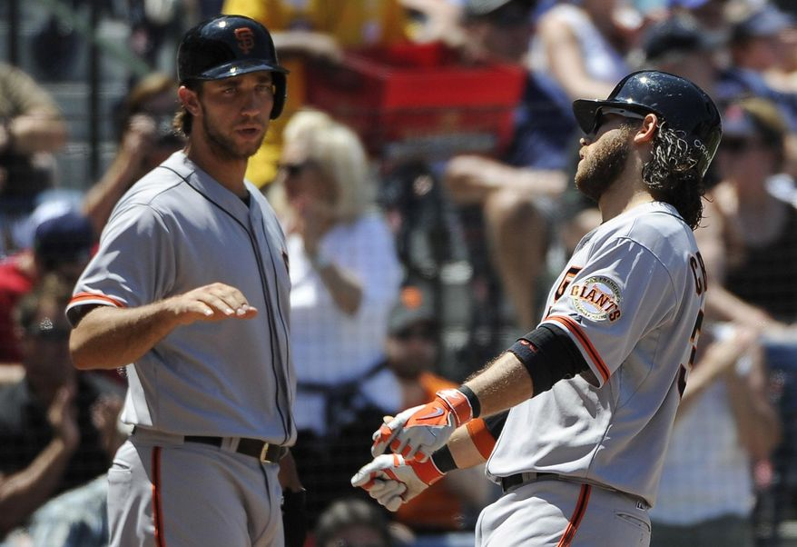 San Francisco Giants' Brandon Crawford, right, is congratulated on his solo home run by teammate Madison Bumgarner during the fourth inning of a baseball game on Sunday, May 4, 2014, in Atlanta. (AP Photo/David Tulis)