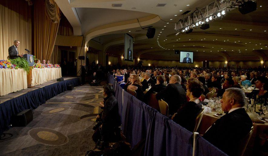 President Barack Obama, left, speaks during the White House Correspondents' Association (WHCA) Dinner at the Washington Hilton Hotel, Saturday, May 3, 2014, in Washington. (AP Photo/Jacquelyn Martin)