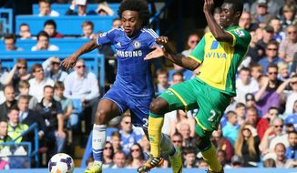 Chelsea's Willian, left is challenged by Norwich's Alexander Tettey during their English Premier League soccer match between Chelsea and Norwich City at Stamford Bridge stadium in London Sunday, May 4, 2014. (AP Photo/Alastair Grant)