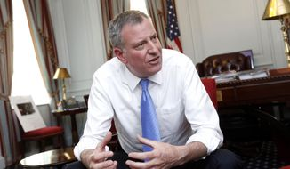 ** FILE ** In this April 9, 2014, file photo, New York Mayor Bill de Blasio gives an interview to The Associated Press on a variety of subjects, including an affordable housing plan, at City Hall in New York. (AP Photo/Jason DeCrow, File)