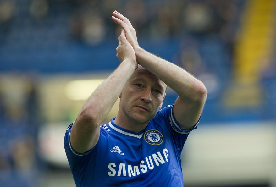 Chelsea's John Terry applauds the fans as he walks around the pitch at the end of their English Premier League soccer match against Norwich City, at the Stamford Bridge Stadium in London, Sunday, May 4, 2014. (AP Photo/Bogdan Maran)