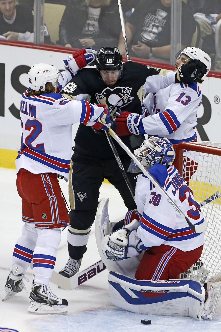 Pittsburgh Penguins' James Neal (18) is sandwiched between New York Rangers' Carl Hagelin (62) and Daniel Carcillo (13) to keep him from a loose puck in front of Rangers goalie Henrik Lundqvist (30) in the first period of game 2 of a second-round NHL playoff hockey series in Pittsburgh Sunday, May 4, 2014. (AP Photo/Gene J. Puskar)