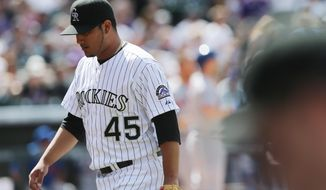 Colorado Rockies starting pitcher Jhoulys Chacin heads back to dugout after giving up one run to the New York Mets in the fourth inning of a baseball game in Denver on Sunday, May 4, 2014. Chacin was making his first appearance of the season with his start against the Mets. (AP Photo/David Zalubowski)