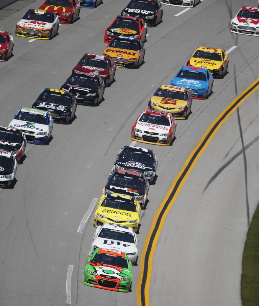 Danica Patrick (10) leads the pack during the NASCAR Aaron's 499 Sprint Cup series auto race at Talladega Superspeedway, Sunday, May 4, 2014, in Talladega, Ala. (AP Photo/John Bazemore)