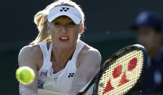 Elena Baltacha of Britain returns a shot  to Petra Kvitova of the Czech Republic during a second round women's singles match at the All England Lawn Tennis Championships at Wimbledon, England, Thursday, June 28, 2012. (AP Photo/Kirsty Wigglesworth)