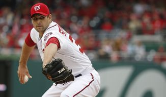 Washington Nationals relief pitcher Craig Stammen (35) throws during the baseball home opener against the Atlanta Braves at Nationals Park Friday, April 4, 2014, in Washington. The Atlanta Braves defeated the Nationals 2-1. (AP Photo/Alex Brandon)