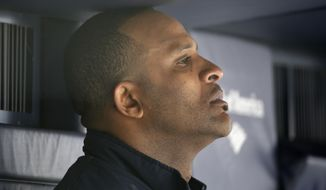 New York Yankees starting pitcher CC Sabathia sits in the dugout after manager Joe Girardi removed him from a baseball game against the Tampa Bay Rays at Yankee Stadium in New York, Sunday, May 4, 2014. (AP Photo/Kathy Willens)