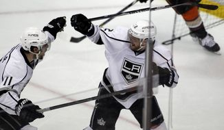 Los Angeles Kings right wing Marian Gaborik, right, celebrates his goal with center Anze Kopitar (11), of Slovenia, to defeat the Anaheim Ducks during overtime in Game 1 of an NHL hockey second-round Stanley Cup playoff series in Anaheim, Calif., Saturday, May 3, 2014. Kings won 3-2 in the overtime. (AP Photo/Alex Gallardo)