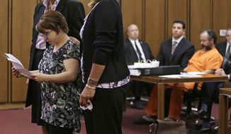 FILE - In this Thursday, Aug. 1, 2013 file photo, Michelle Knight speaks during the sentencing phase for Ariel Castro, right, in a Cleveland courtroom. The list of missing people in Cleveland makes up about one out of every 10 cases in the entire state. Most are found within a few weeks, but there are more than 22 people who have been gone for more than a year. (AP Photo/Tony Dejak, File)