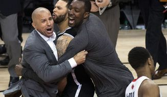 Brooklyn Nets head coach Jason Kidd, left, and teammates Deron Williams, center, and Andray Blatche react after defeating the Toronto Raptors in Game 7 of the opening-round NBA basketball playoff series in Toronto, Sunday, May 4, 2014. (AP Photo/The Canadian Press, Nathan Denette)